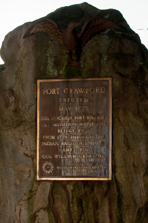 "Monument to Colonel William Crawford. Dedicated by the Daughters of the American Revolution. Monument says, ""FORT CRAWFORD ERECTED MAY 1775 THIS STOCKADE WAS USED AS A MUNIITION-SUPPLY AND REFUGE POST FROM 1776 THROUGH THE INDIAN RAIDS OF 1791-1793 NAMED FOR COL. WILLIAM CRAWFORD. PLACED BY MASSY HARBISON CHAPTER D.A.R. 1942)"