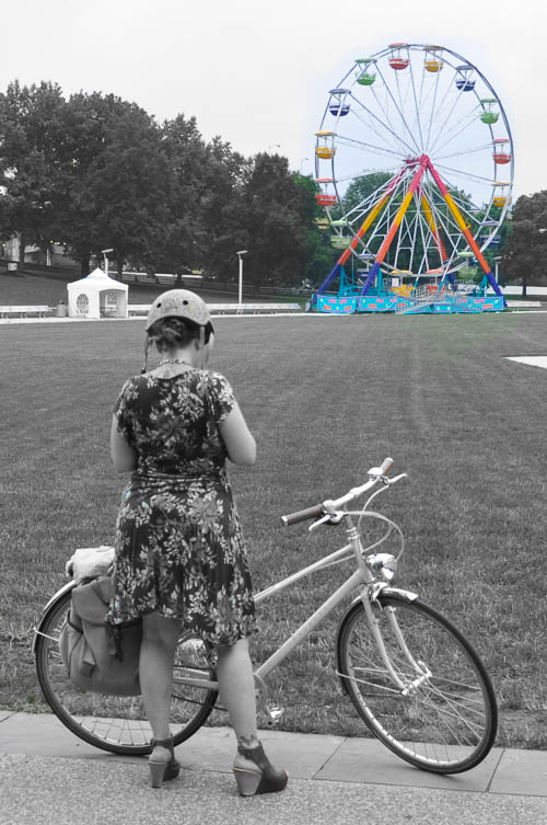 Girl on bike. Ferris Wheel. Point State Park. Pittsburgh, Pennsylvania.